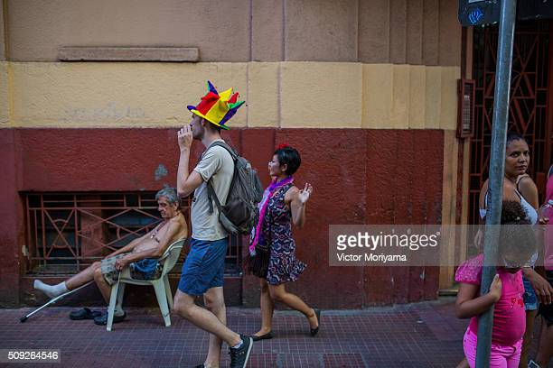 Revellers participate in the Carnival group parade honoring the singer David Bowie through the streets of downtown on February 9 2016 in Sao Paulo...