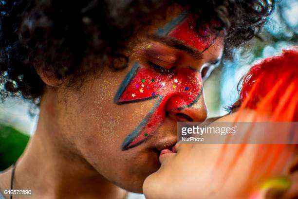 Revellers participate in the Carnival group parade honoring the singer David Bowie through the streets of downtown on February 28 2017 in Sao Paulo...