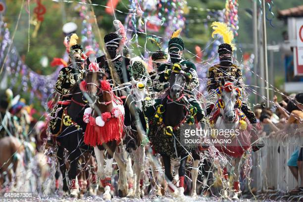 TOPSHOT Revellers participate in the traditional carnival on horseback in Bonfim Minas Gerais state southeastern Brazil on February 27 2017 Dressed...