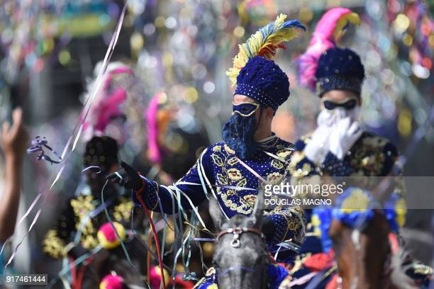 Revellers participate in the traditional carnival on horseback in Bonfim Minas Gerais state southeastern Brazil on February 12 2018 Dressed in...