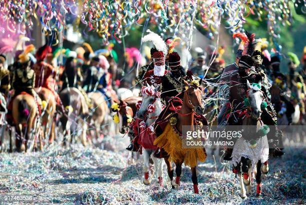 TOPSHOT Revellers participate in the traditional carnival on horseback in Bonfim Minas Gerais state southeastern Brazil on February 12 2018 Dressed...
