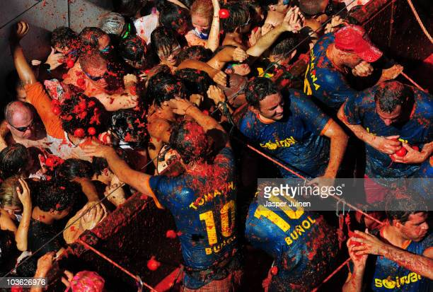 Revellers pelt each other with tomatoes during the world's biggest tomato fight at La Tomatina festival on August 25 2010 in Bunol Spain More than...