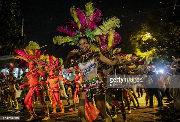 Revellers perform at the Guacherna parade during precarnival in Barranquilla Colombia on February 22 2014 Barranquilla's Carnival a tradition created...