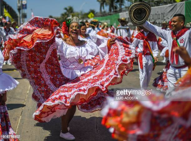 Revellers perform during Barranquilla's Carnival parade in Barranquilla Colombia on February 10 2018 / AFP PHOTO / Luis ACOSTA