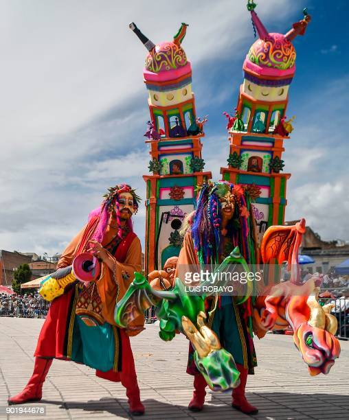 Revellers perform in the White Day parade on January 6 during the Carnival of Blacks and Whites in Pasto Colombia the largest festivity in the...