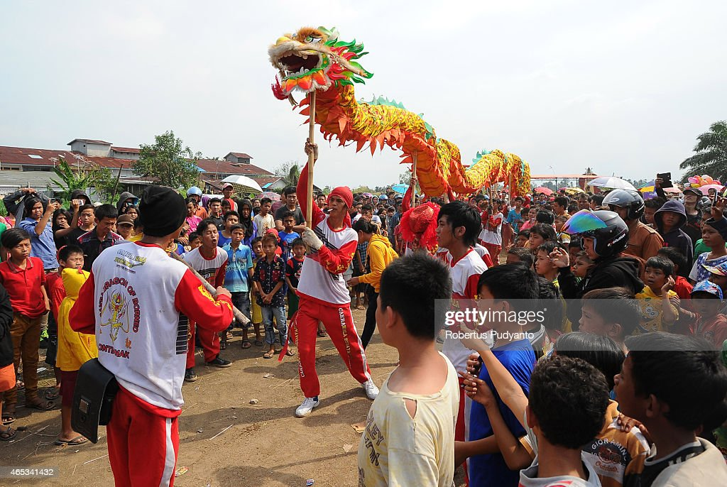PONTIANAK, KALIMANTAN, INDONESIA - MARCH 06: Revellers perform the 'Chinese Dragon' dance during Cap Gomeh Celebrations on March 6, 2015 in Pontianak, Kalimantan, Indonesia. The Chinese Dragon dance is often performed during Chinese New Year celebration, as it is believed to bring good improvements in health, prosperity, and fortune. Cap Go Meh Festival also know as the Lantern Festival is celebrated on the 15th day of the Chinese Lunar Year and the Dragons are burnt to mark the end of Chinese New Year celebration.