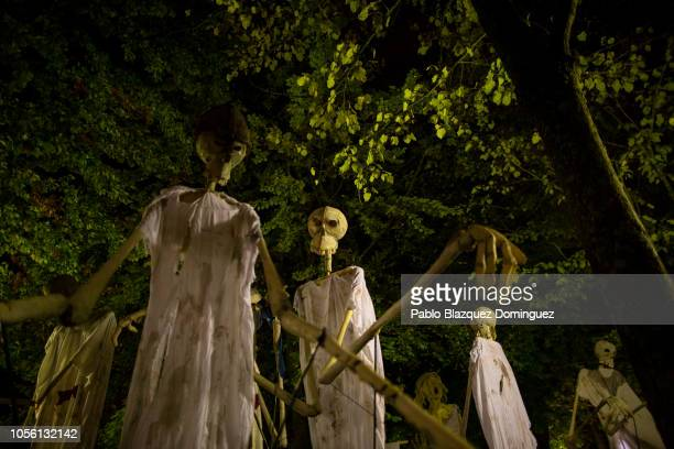 Revellers perform with giant puppets during the 'Night of the Souls' parade on November 1 2018 in Soria Spain 'La Noche de las Animas takes place in...