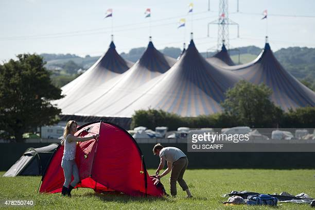 Revellers pitch their tent as they arrive to attend the Glastonbury Festival of Music and Performing Arts on Worthy Farm near the village of Pilton...