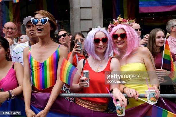 Revellers pose for a photo during the parade Thousands of revellers filled Londons streets with colour to celebrate Pride in the capital city 2019...