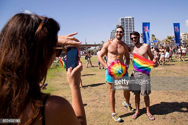 Revellers pose for a picture during a gay pride parade in Tel Aviv Israel on June 12 2015 According to organisers and police about 180000 between...