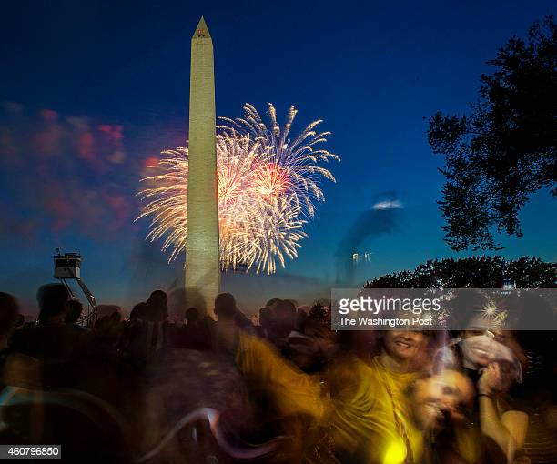 Revellers pose for cell phone snapshots during the annual Independence Day fireworks display at the Washington Monument on July 2014 in Washington DC