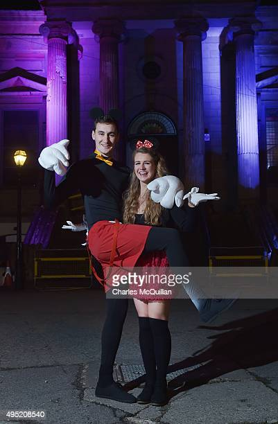 Revellers pose for photographs as they arrive for a Gothic Ball taking place inside a former church on October 31 2015 in Londonderry Northern...