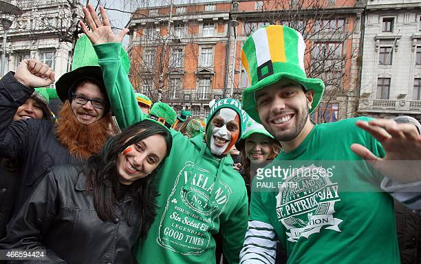 Revellers pose for pictures as they take part in the St Patrick's Day Parade in Dublin Ireland on March 17 2015 AFP PHOTO / Paul Faith