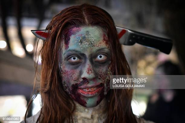 Revellers pose for pictures during the annual' Zombie' walk infuenced by horror movies during the carnival season in Athens on February 10 2018AFP...