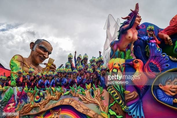 Revellers pose on a float during the White Day parade on January 6 during the Carnival of Blacks and Whites in Pasto Colombia the largest festivity...