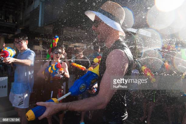 Revellers reacts during a water fight at Songkran Festival celebrations in Bangkok Thailand on April 13 2017 The three day Songkran festival is the...