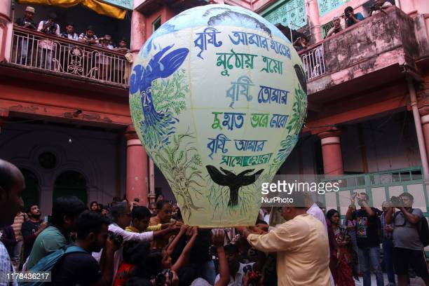 Revellers release a handmade paper lantern as they celebrate during the quotDiwaliquot Hindu festival in Kolkata on October 27 2019 quotDiwaliquot...