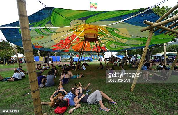 Revellers rest under a tent structure during at the Rototom Sunsplash Reggae festival in Benicassim Castellon province on August 14 2015 Rototom runs...