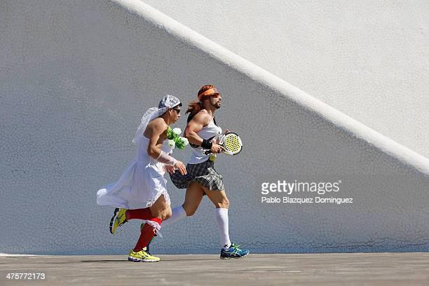 Revellers run around the Adan Martin Auditorium during Carnival Running the first 5 kilometre long race to be held during the Santa Cruz de Tenerife...