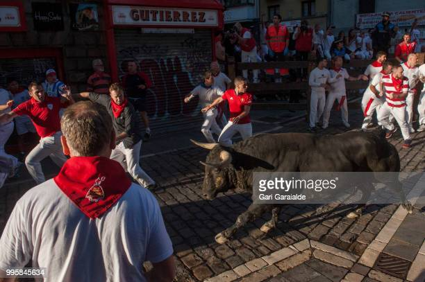 Revellers run with Nunez del Cubillo's fighting bulls during the sixth day of the San Fermin Running of the Bulls festival on July 11 2018 in...
