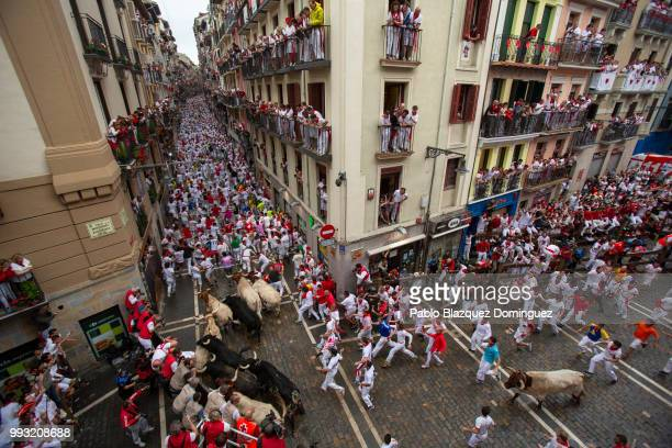 Revellers run with Puerto de San Lorenzo's fighting bulls during the second day of the San Fermin Running of the Bulls festival on July 7 2018 in...