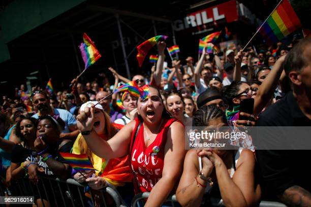 Revellers standing on Seventh Avenue watch the annual Pride Parade on June 24 2018 in New York City The first gay pride parade in the US was held in...