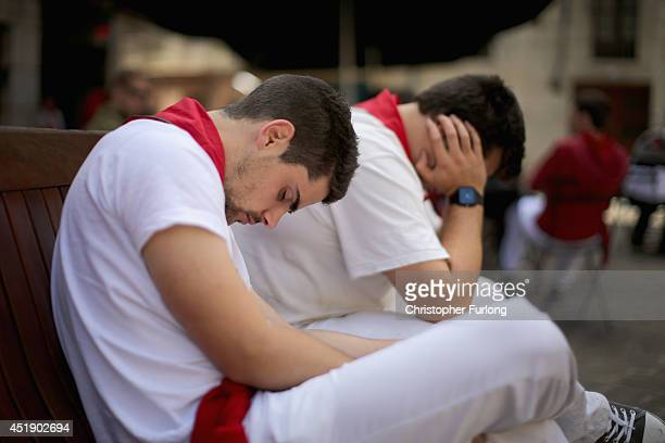 Revellers take an afternoon siesta sleeping off the effects of partying during the fourth day of the San Fermin Running Of The Bulls festival on July...