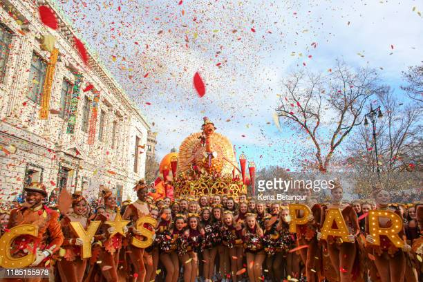 Revellers take during the annual Macy's Thanksgiving parade on November 28 2019 in New York City