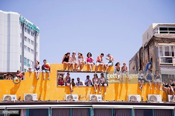 Revellers take part in a gay pride parade in Tel Aviv Israel on June 12 2015 According to organisers and police about 180000 between Israelis and...