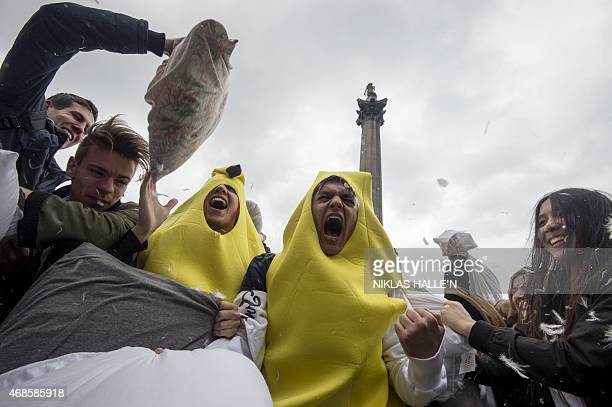 Revellers take part in a mass pillow fight in Trafalgar Square on International Pillow Fight Day in central London on April 4 2015 AFP PHOTO / NIKLAS...