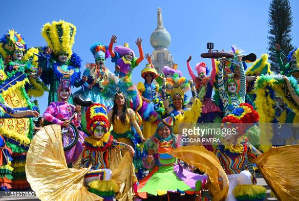Revellers take part in a parade marking the start of the festival of the Divino Salvador del Mundo , San Salvador's patron saint, in San Salvador, on...