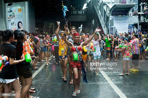 Revellers take part in a water fight during the Songkran water festival in Silom road on April 13 2015 in Bangkok Thailand The Songkran festival...