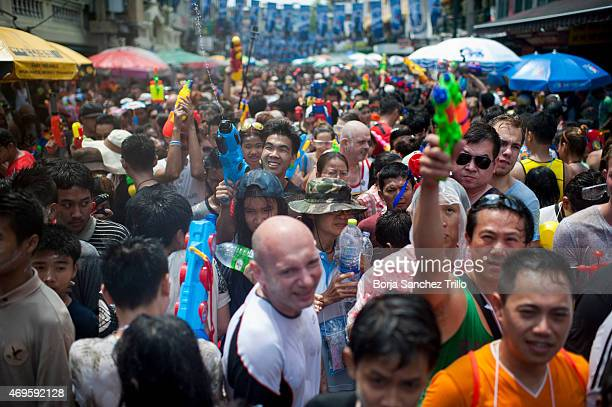 Revellers take part in a water fight during the Songkran water festival in Khao San road on April 13 2015 in Bangkok Thailand The Songkran festival...
