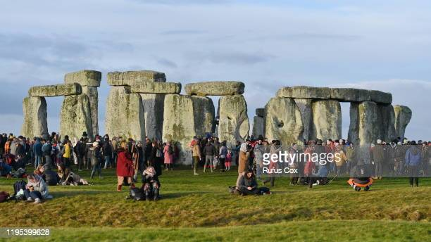 Revellers take part in celebrations to mark the winter solstice at Stonehenge prehistoric monument on December 22, 2019 in Wiltshire, England....