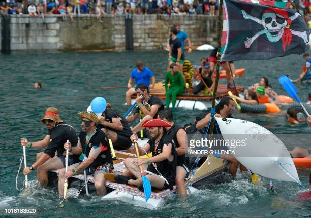 Revellers take part in the Abordaia Festival during the festivities of the Spanish Basque city of San Sebastian on August 13 2018