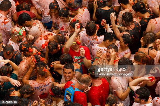 Revellers take part in the annual Tomatina festival on August 30 2017 in Bunol Spain An estimated 22000 people threw 150 tons of ripe tomatoes in the...