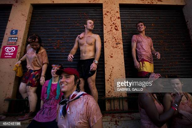 Revellers take part in the annual 'tomatina' festivities in the village of Bunol near Valencia on August 27 2014 Some 22000 revellers hurled 130...