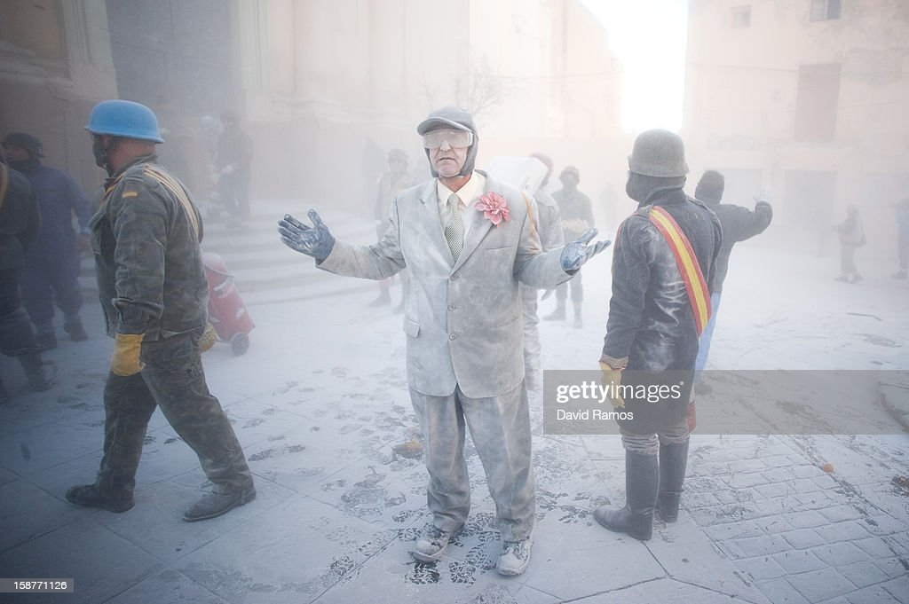 Revellers take part in the battle of 'Enfarinats', a flour fight in celebration of the Els Enfarinats festival on December 28, 2012 in Ibi, Spain. Citizens of Ibi annually celebrate the festival with a battle using flour, eggs and firecrackers. The battle takes place between two groups, a group of married men called 'Els Enfarinats' which take the control of the village for one day pronouncing a whole of ridiculous laws and fining the citizens that infringe them and a group called 'La Oposicio' which try to restore order. At the end of the day the money collected from the fines is donated to charitable causes in the village. The festival has been celebrated since 1981 after the town of Ibi recovered the tradition but the origins remain unknown.Ê