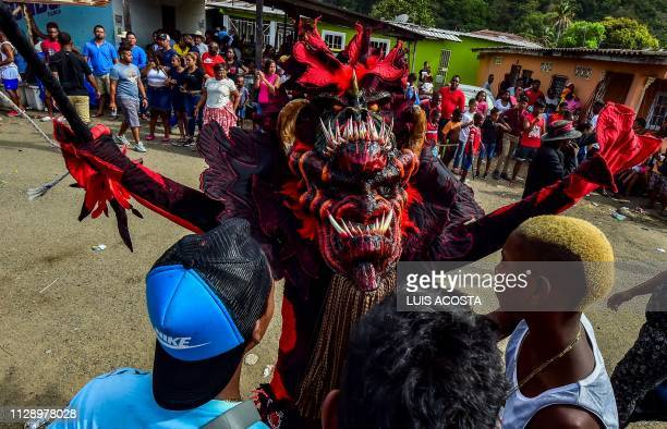 Revellers take part in the 'Congos and Devils' carnival festival in Nombre de Dios 120 km north of Panama City on March 6 2019 The celebration dates...
