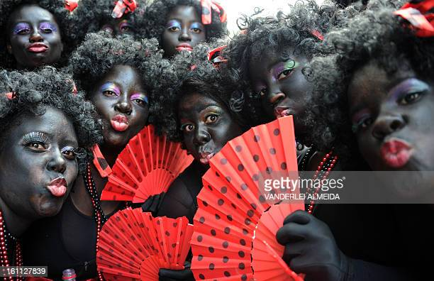 Revellers take part in the 'Cordao do Bola Preta' traditional carnival band parade along Rio Branco avenue in downtown Rio de Janeiro Brazil on...