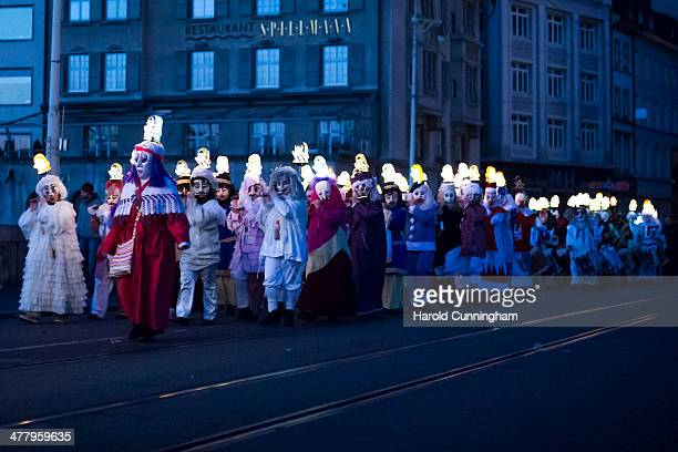 Revellers take part in the 'Morgestraich' marking the opening of the Basel Fasnacht Carnival on March 10, 2014 in Basel, Switzerland. Starting at...