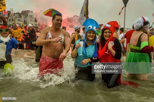 Revellers take part in the traditional 'Bain de Givres' as part of the New Year's celebrations on January 1 2018 at MaloLesBains beach in Dunkirk...