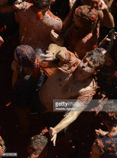 Revellers throw tomatoes while participating the annual La Tomatina festival on August 27 2014 in Bunol district of Valencia Spain