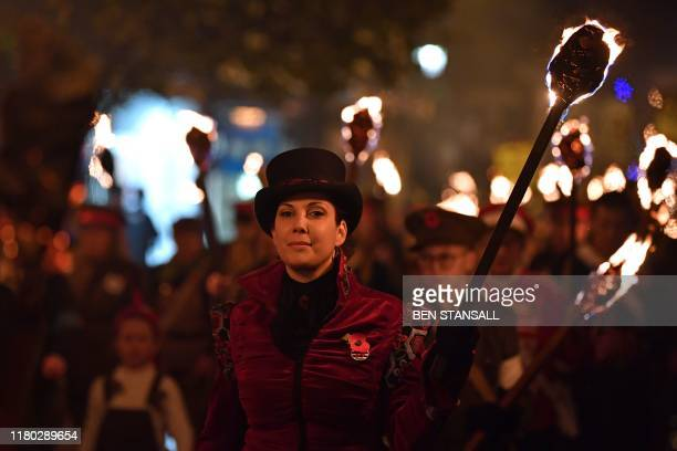 Revellers' torches are carried through the streets of Lewes in East Sussex southern England on November 5 during the traditional Bonfire Night...
