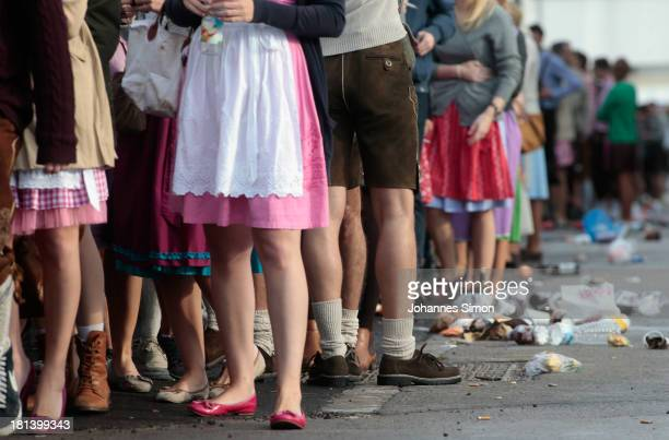 Revellers wait for entry in front of a beer tent during day 1 of the Oktoberfest 2013 beer festival at Theresienwiese on September 21 2013 in Munich...