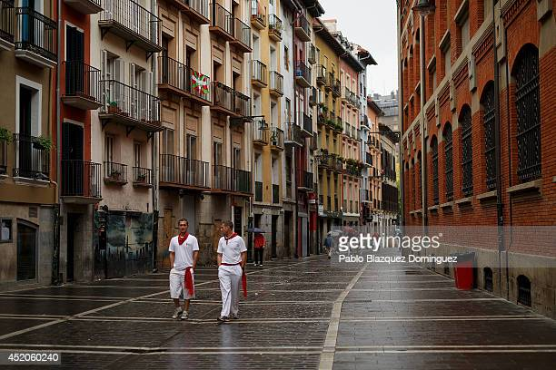 Revellers walk in the street during the seventh day of the San Fermin Running Of The Bulls festival on July 12 2014 in Pamplona Spain The annual...