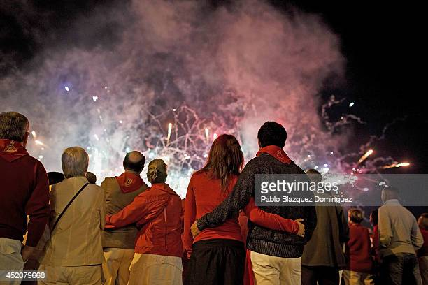 Revellers watch fireworks during the seventh day of the San Fermin Running Of The Bulls festival on July 12 2014 in Pamplona Spain The annual Fiesta...