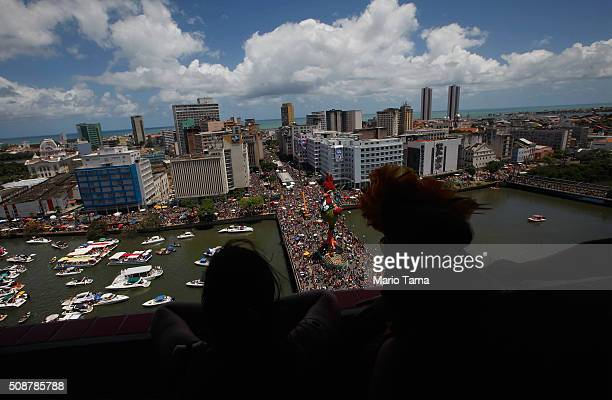 Revellers watch from a hotel rooftop during Carnival celebrations on February 6 2016 in Recife Pernambuco state Brazil Carnival celebrations...