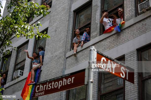 Revellers watch the annual Pride Parade from windows on June 24 2018 in New York City The first gay pride parade in the US was held in Central Park...
