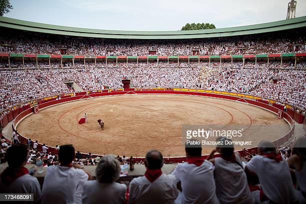 Revellers watch the bullfights with Miura's fighting bulls at the bullring on the ninth day of the San Fermin Running Of The Bulls festival on July...